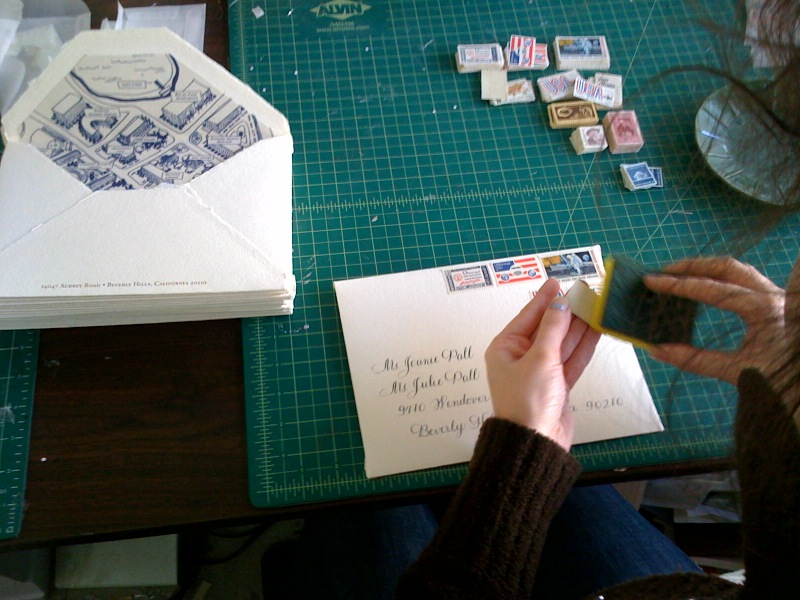 stamps and envelopes and hands