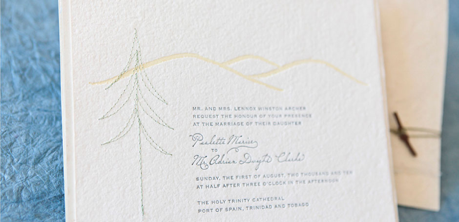 Stitched pine tree wedding invitation in folder