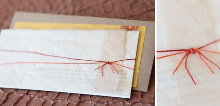 Length-wise letterpress wedding invitation with muslin wrap, twine tie and kraft paper envelope.