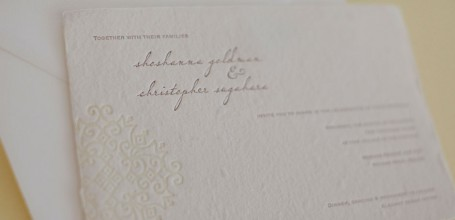 Letterpress wedding invitation on handmade paper.