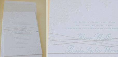 White on light blue letterpress wedding invitation.