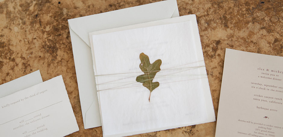 Pressed leaf wedding invitation with reply card