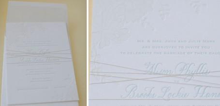 White on light blue letterpress wedding invitation.